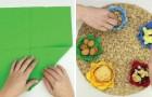 Ze vouwt servetten en verkrijgt hiermee vrolijk gekleurde snackkommetjes!