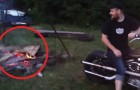 The firewood has been lit but needs a boost! A guy decides to use his Harley Davidson!