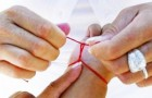 The legend of the red thread: A powerful amulet that is tied on the wrist to chase away negativity