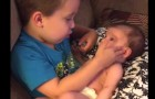 A little boy asks to hold his newborn sister in his arms as he tenderly sings her a song