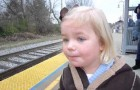 The amazement of a young girl when the train arrives