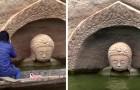 Una magnifica statua di Buddha di 600 anni fa riemerge dalle acque di un lago