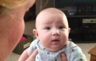 L'expression du bébé en dit long: pas de chat ici!!