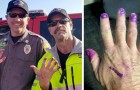 These two firefighters help a scared little girl and to calm her they let her paint their nails