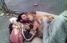 This homeless man sleeps embraced by a four-legged angel that never abandons him