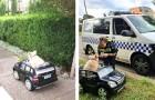 Due poliziotti non possono fare a meno di fermarsi vedendo un cane che