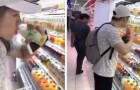 Two teenagers at the supermarket drink bottles of fruit juice and put them back on the shelf to