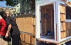 A young man builds a mini-house for a homeless woman living in his neighborhood