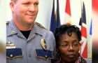 En 56-årig kvinna räddar livet på en polis genom att hoppa på mannen som attackerat honom