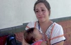 A crying mom is kicked out of a water park - she was breastfeeding her baby