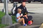 Un policía consuela a un niño asustado después de un accidente de tránsito: una mujer fotografía la escena impactante