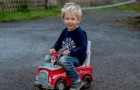 A 3-year-old boy crosses the road in his toy car to save his dad's life