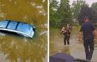Drei Polizisten schwimmen, um eine in ihrem Auto gefangene 82-jährige Frau aus einer Überschwemmung zu retten