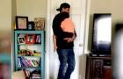 Técnico de la línea telefónica ayuda a una mamá en dificultad tomando en brazos a su hijo enfermo