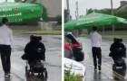 A bartender borrows a massive umbrella from the restaurant to escort a customer home in the rain