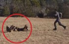 He orders his dogs to stand still in the park. Now watch what he does !