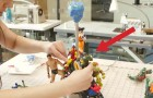 She glues superheroes at the base of a lamp ... the final result is AMAZING!