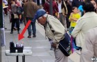 They sets up a stall for charity in the street: the behavior of people passing by is amazing !