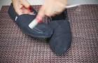 Elle commence à frotter une bougie sur des chaussures: cette astuce va vous servir!