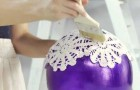 She puts doilies on a balloon and creates a crazy piece of furniture !