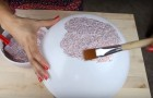 She mixes glitter and glue in a bowl and creates a really awesome object !