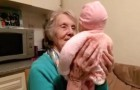 A grandmother is cuddling a baby, but look closely at his face when she turns him...