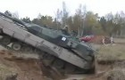 An armored tank falls into a pit ... The solution to getting it out is ... POWERFUL!