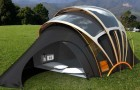 Does camping frighten you? --- Relax! Here's a tent with light, heat, electricity, AND the Internet!
