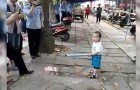 A grandmother is told to close her street stall --- Her grandson's reaction is a sight to behold!