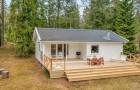 Une maison de 1975 nichée dans les bois suédois : un joyau de nature et de design