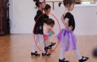 A little girl attempts to follow the dance class --- her tenacity will amaze you!