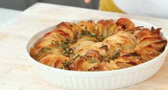 Elle coupe les pommes de terre en tranches fines et prépare un plat qui semble créé par un vrai chef