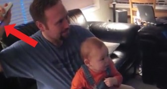 When dad turns on the Wii . . . watch his baby son's reaction!
