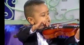 The 3 year child playing the violin