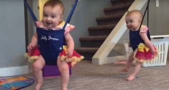Twin Babies Dancing in sling swings --- Hilarious!