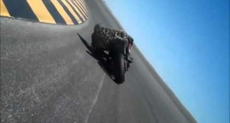 Crazy rider  touches the road with his head without falling