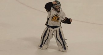 Talented dancing goalie joyfully taunts the losing team!