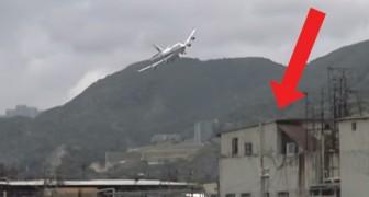De vliegtuigen op deze luchthaven in Hong Kong vlogen bijna rakelings langs de huizen om te landen!