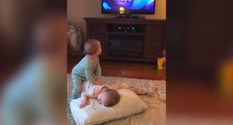 These twins seem to be watching TV but the video that their Mom makes is much more fun!