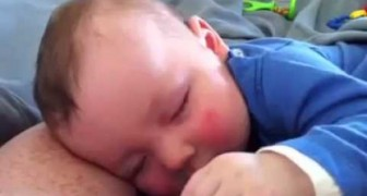 Cute baby laughing while sleeping