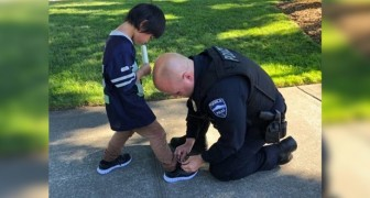 Two police officers buy shoes for a child after seeing him walking with dirty socks