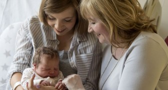 While all focus on the newborn baby, a grandmother focuses on the new mom