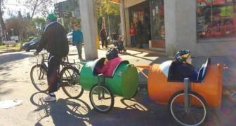 """Per portare a spasso i nipotini si inventa la """"bici trenino"""": il semplice gesto di questo nonno commuove il mondo"""