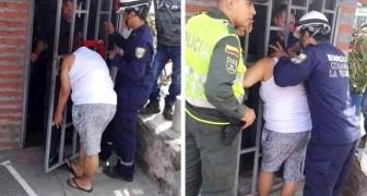 Een nieuwsgierige vrouw probeert het huis van de buren te bespioneren en blijft vijf uur in het hek vast zitten