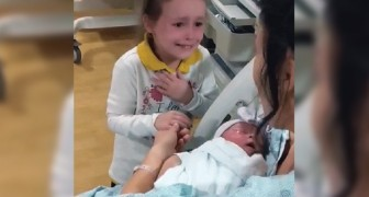 A little girl sees her newborn sister for the first time and starts to cry because of her very strong feelings
