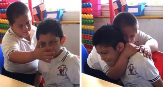 This young boy with Down syndrome embraces and comforts his autistic classmate