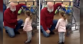 This little girl sees a man with a white beard at the supermarket and mistakes him for Santa Claus