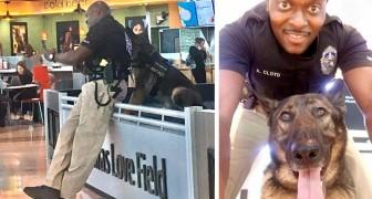 Een vrouw fotografeert een agent terwijl ze schattige selfies maakt met haar politiehond