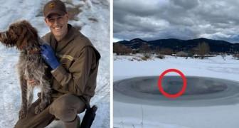 Un coraggioso corriere si è tolto la divisa e si è gettato nello stagno ghiacciato per salvare un cane in difficoltà