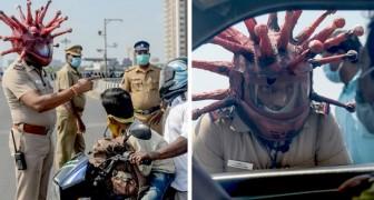India: un agente di polizia indossa un elmetto a forma di Coronavirus per convincere le persone a stare a casa